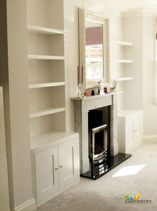 Alcove fitted TV cabinets with bookshelves besides the chimney. Kingston, London.