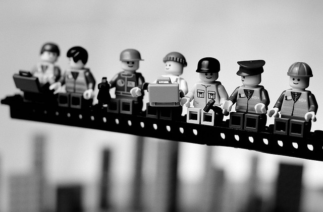 "a lego reconstruction of the famous 1932 photograph ""Lunch atop a skyscraper"" taken by Charles Ebbets"