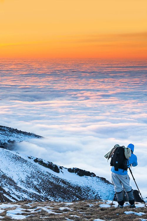 A sea of clouds -- Balkan Mountains, Bulgaria (by Evgeni Dinev). I once saw something very similar from the top of Mount Haleakala (Maui). It is 10,023 feet tall. Went up there to watch the sun rise but we had to wait for it to come out of the clouds to actually see it.