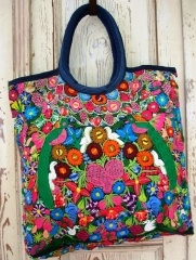 Upcycled handbags made from hand embroidered Mayan women's blouses.  They're beautiful,colorful, one-of-a-kind...fabulous!