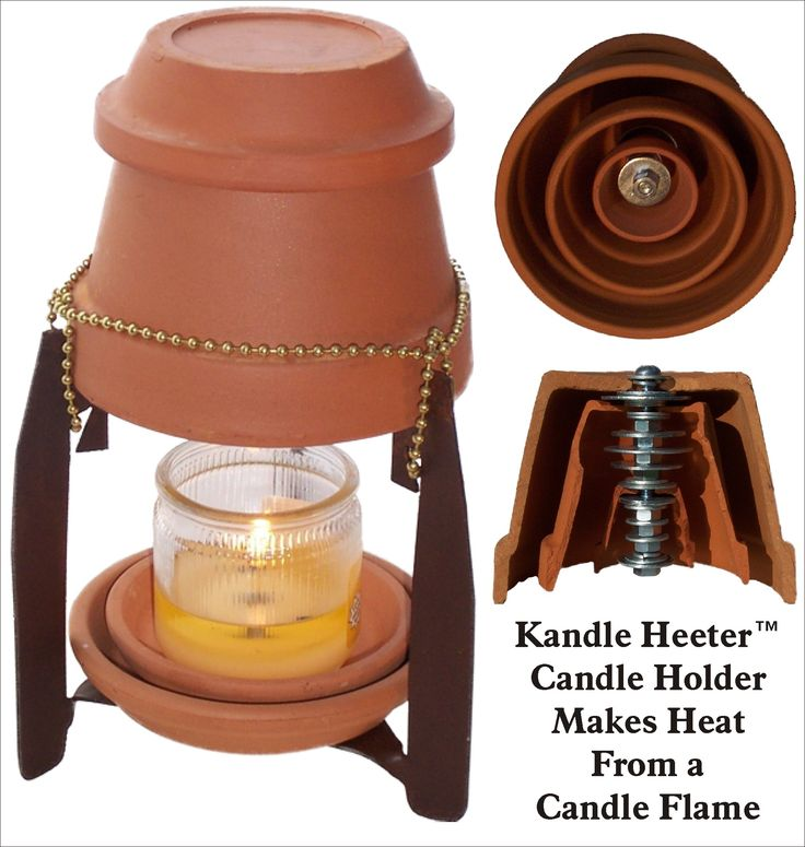 ceramic space heater made from washers and upside down terra cotta flower pots screwed together and sitting on a stand over a candle...