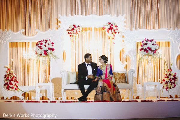 Gorgeous backdrop for this modern south asian wedding. Love the white frame backdrops with fresh flower arrangements.