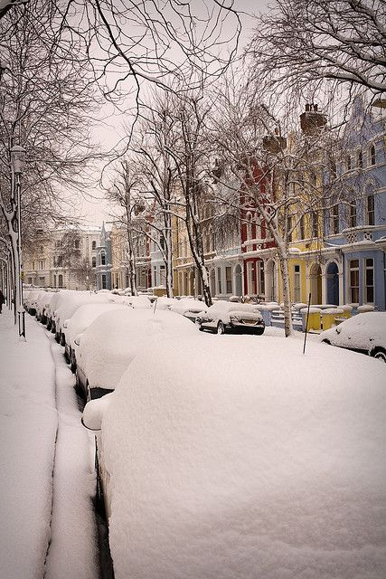 London Street in the Snow. A Notting Hill street with pastel coloured houses.