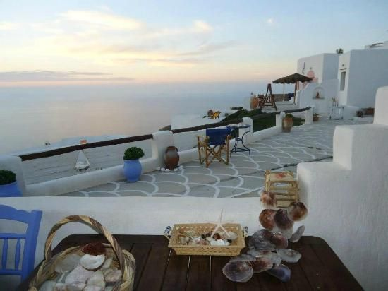 Santorini view from this cute bar in Sikinos island, Greece - selected by www.oiamansion.com
