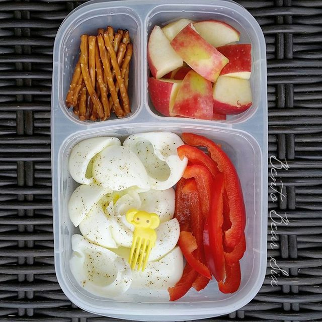 6 hardboiled egg yokes with salt & pepper, red bell pepper strips, apple chunks and pretzels to keep her energized at camp all day long. #BentoBear6 #girlscout #summercamp #easylunchboxes #eggs
