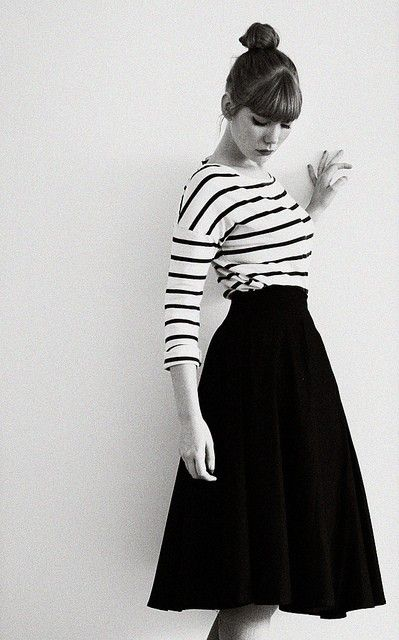 So simple. Striped tee, knee-length skirt, heavy bangs and a top knot.