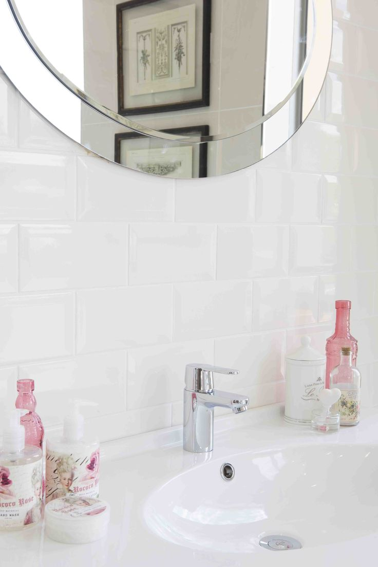 Bathroom accessories in soft kisses of pink complement a #bathroom inspired by romance