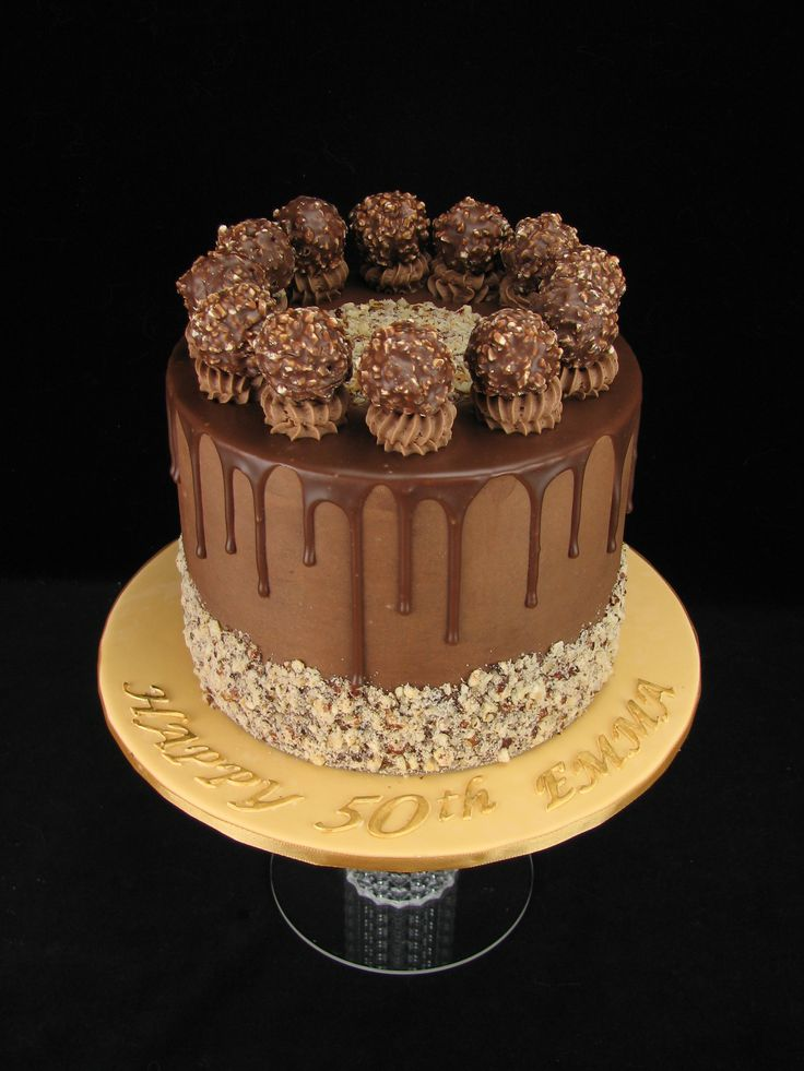 This Ferrero Rocher cake is made up of chocolate mudcake filled and covered in a hazelnut chocolate buttercream with chocolate drip. www.facebook.com/cakesbyleannerhodes