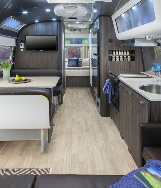 The 28-foot Airstream International Series features interiors by Christopher C. Deam; it sleeps up to six people and includes camping cha...