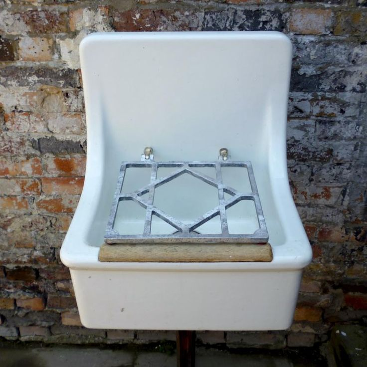 Reclaimed Vintage Mop Butler Sink with grate at thearchitectualforum.com