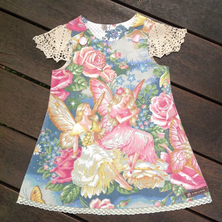 """Upcycled vintage """"Shirley Barber"""" sheeting fabric, doily sleeves, lace trim and fully lined with upcycled sheeting fabric. Similar fabric design on the back.Size 0."""