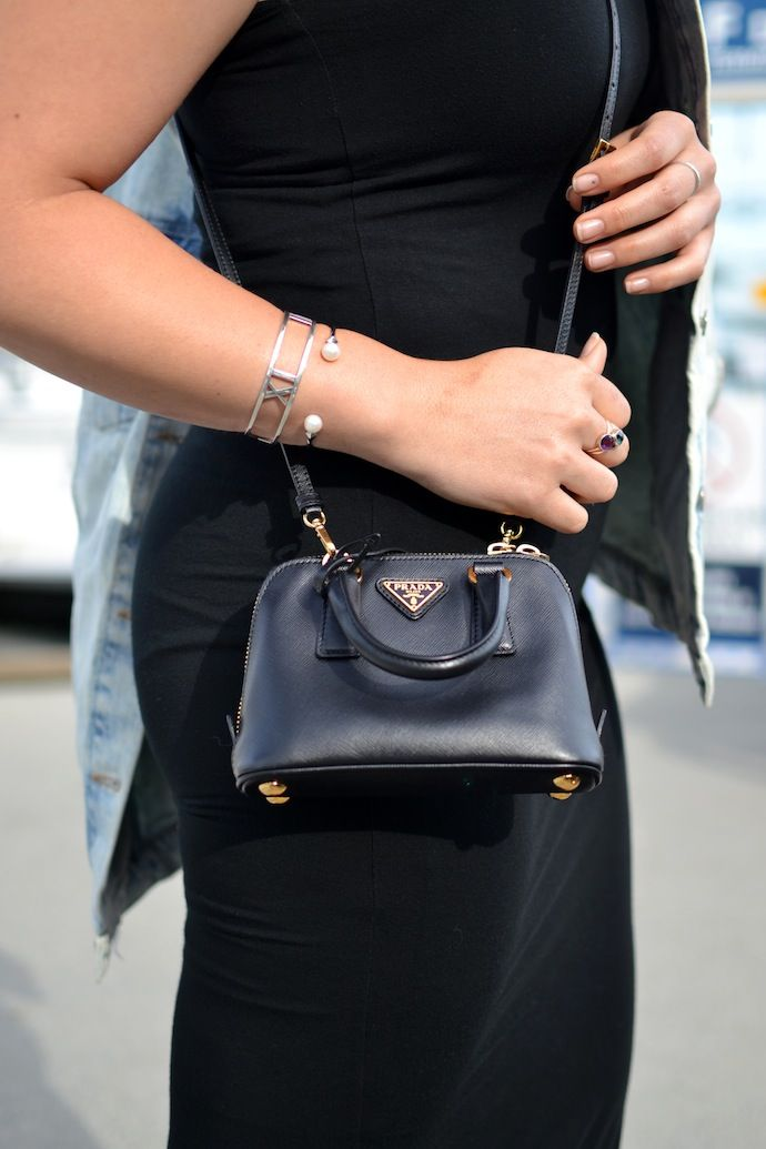 Mini Prada crossbody bag     See more: Covetandacquire.com