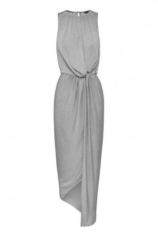Relaxed fit dress in a stretch jersey featuring an assymetrical hem line and open split at front.