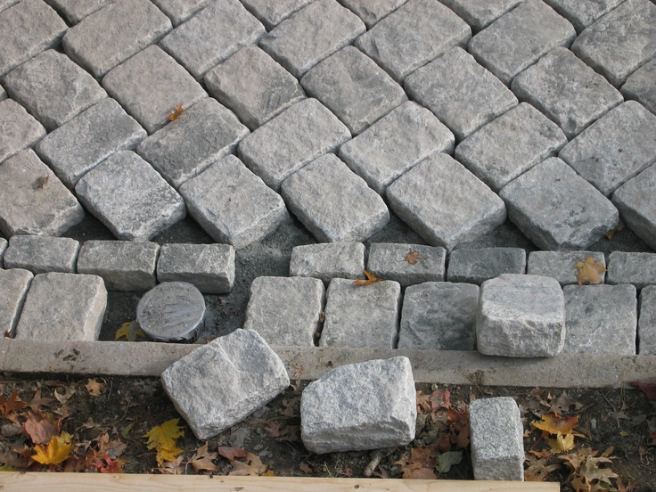 via Tim Lee. granite cobble drive, edging and curb heated driveway - close up