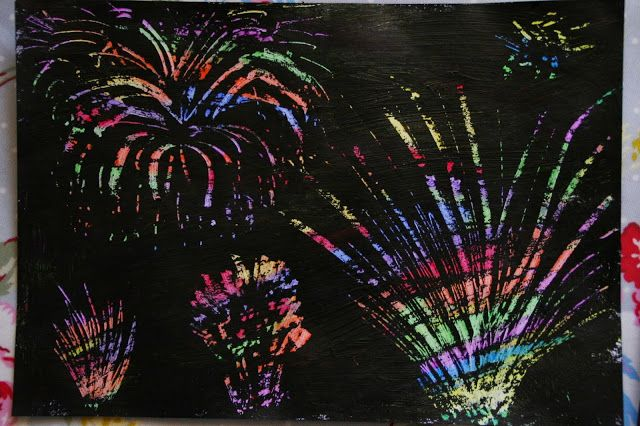 Scratch Art Fireworks.  Completely colour with crayons, cover lightly with black acrylic paint, dry, scratch fireworks with a skewer/plastic fork. Mount on coloured cardboard