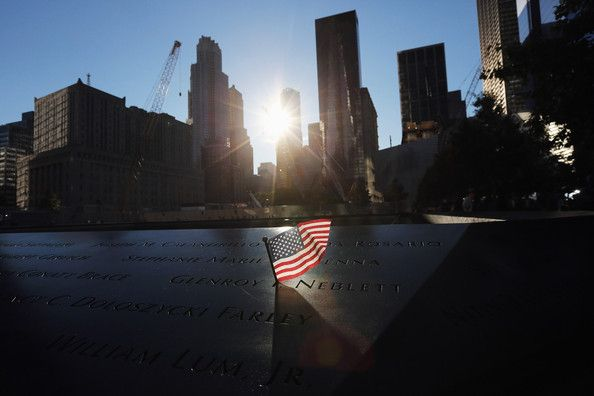 A flag sits in a name of the 9/11 Memorial before ceremonies for the eleventh anniversary of the terrorist attacks on lower Manhattan at the World Trade Center on September 11, 2012 in New York City. New York City and the nation are commemorating the eleventh anniversary of the September 11, 2001