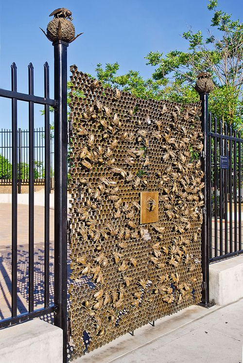 Bees for Sunset Park, 2013 © Christopher Russell. 9th Avenue Station, Brooklyn. Commissioned and owned by MTA Arts for Transit and Urban Design. Consisting of two sets of bronze ornamental gates, 7 feet high and 6 feet wide, and a series of large finials on the fences surrounding the site.The gates depict honeybees crawling on hives, and the posts of adjacent fences have honeybees resting on 17 finials shaped like flower heads. There are 400 bees spread across the 4 doors.