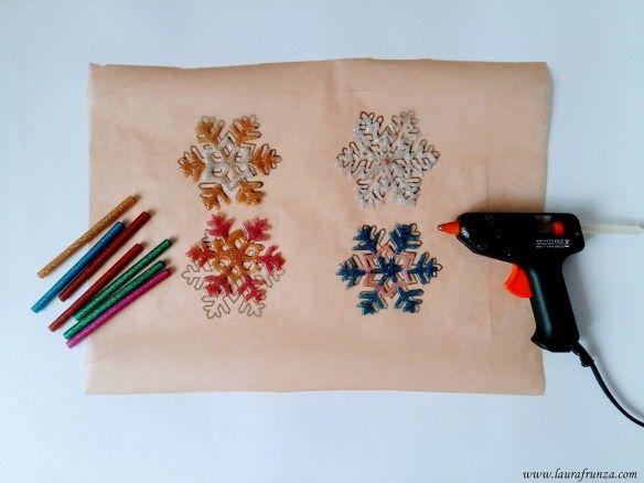 Glue gun snowflakes - use sparkly/glittery glue sticks