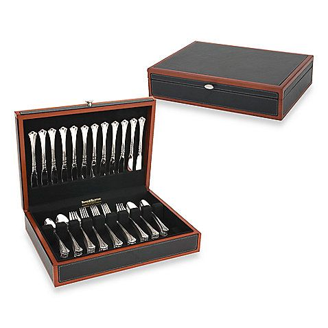 Finely appointed with a textured faux leather exterior, this contemporary flatware chest offers ample room for your flatware. A cherry finish trim contrasts with the black to create a dramatic design statement.