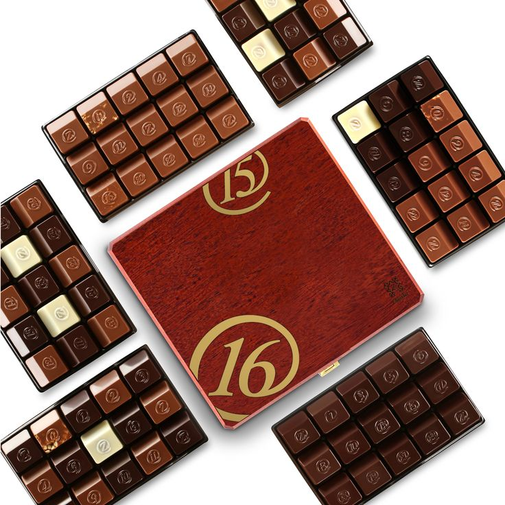 Honor the New Year with elegance by offering a bold, rich-toned mahogany box. This 2016-themed box opens to a stunning 6 layers of the ultimate in fine French chocolate including our 2 most popular traditional and exotic assortments - revealing our entire numbered collection... and much more! [USD 276.61]   Discover our New Year Jade 6: http://www.zchocolat.com/shop/en/new-years-collection/492-new-year-jade-6.html