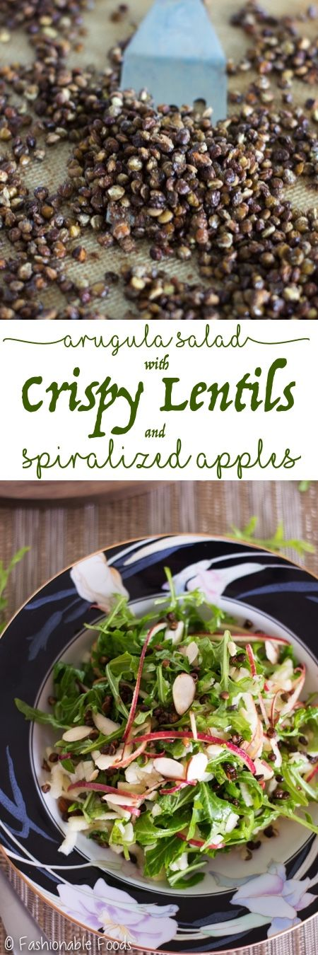 Spicy arugula is tossed with crispy baked lentils and fresh apples in this delicious vegan salad. One bite and you won't be able to resist this arugula salad with crispy lentils and spiralized apples!