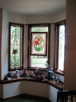 bay window idea love the stained glass hung from curtain