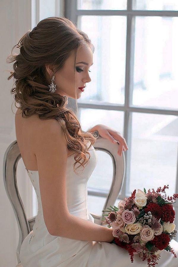 tsvetkovasstudio long wavy wedding hairstyles / http://www.himisspuff.com/bridal-wedding-hairstyles-for-long-hair/36/
