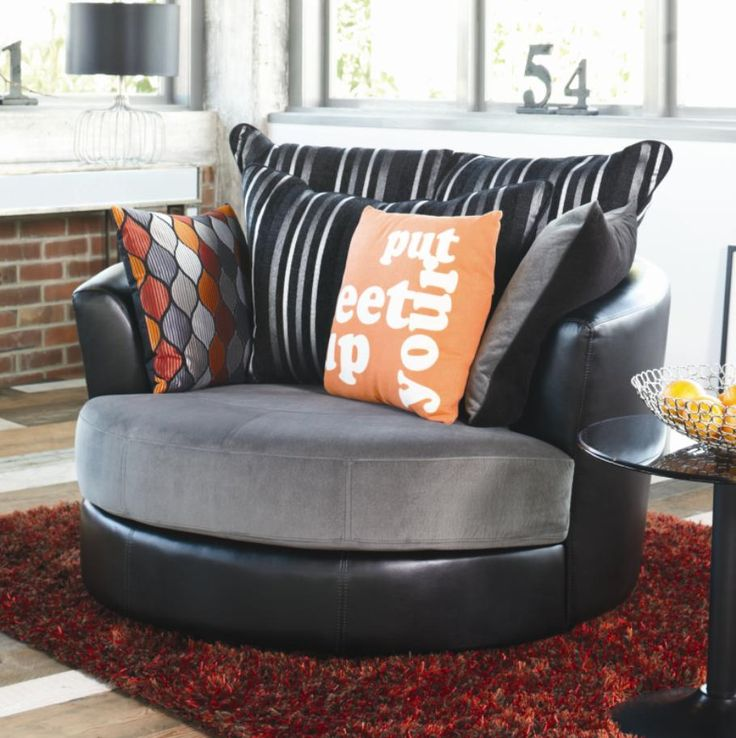 Sink into comfort with the Boston swivel chair.