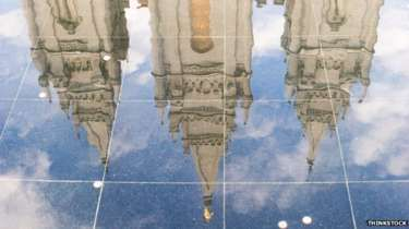 The reflection of a Mormon Temple on a shiny floor