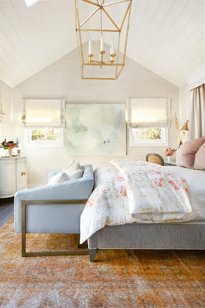 Bedroom features a Darlana Lantern lighting, Grasscloth wallpaper from Thibaut. The rug is from Aga John in San Francisco. The beautiful duvet is from Lindsay Cowel fabrics that the designer had custom made.  Kim Scodro Interiors.  Michelle Drewes Photography.