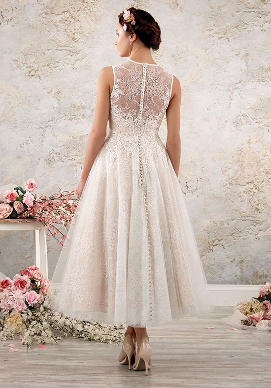 A full, swinging tea length skirt gives this lacy boho chic wedding dress a vintage-inspired feel. A sleeveless sheer yoke over the sweetheart, natural waist bodice adds delicate grace.