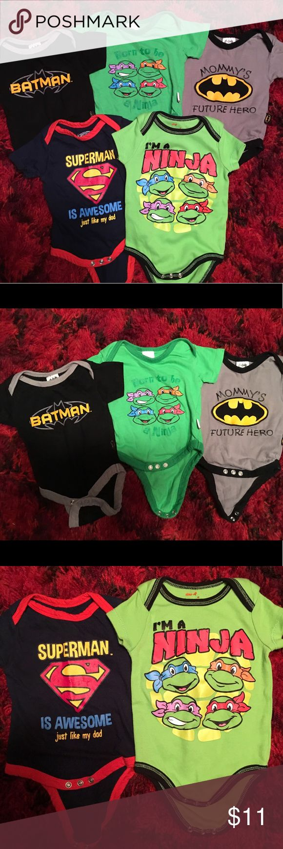 Superhero Infant Onesies Bundle Top row in pic: Black Batman onesie; green Teenage Mutant Ninja Turtles onesie; gray Batman onesie (all 3 are size 0-3 months.) Bottom row in pic: Superman onesie; Teenage Mutant Ninja Turtles onesie (both are size 3-6 months.) All onesies are in great condition with light wear. No stains, rips, holes. My guy outgrew and can no longer use. Comes from a smoke free home. Please make an offer if interested; reasonable offers will be accepted. Thanks!! One Pieces