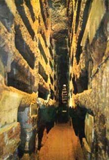 The catacombs of St. Callixtus. Salesian Istitute S.t Callixtus, Rome. The christian catacombs of Rome. Catacomb of Priscilla. Rome, Italy. Late Antique Europe. c. 200–400 C.E. Excavated tufa and fresco.
