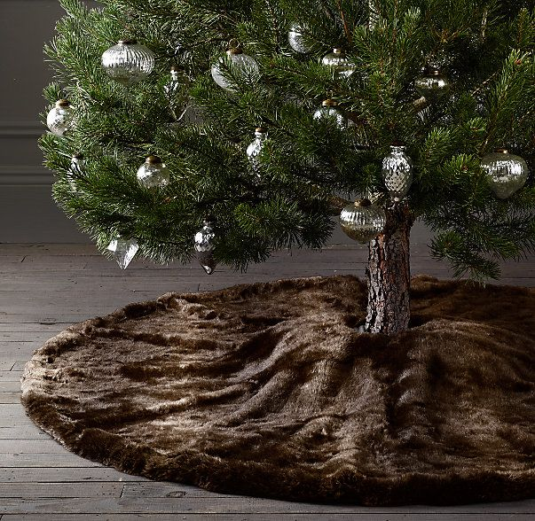 RH's Luxe Faux Fur Tree Skirt:Drape a layer of luxury under the tree with our sumptuous fur skirt, part of our luxe faux fur collection. Artfully woven from finely spun strands, the skirt beautifully re-creates the natural weight, depth of color and indulgent softness of genuine fur.