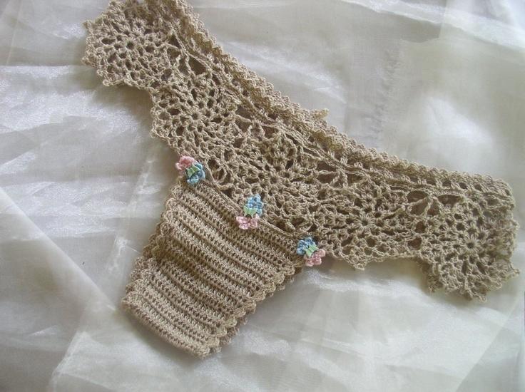 Free Pattern: http://www.ravelry.com/patterns/library/motif-lace-tanga Motif Lace Tanga in Silk Camel yarn.