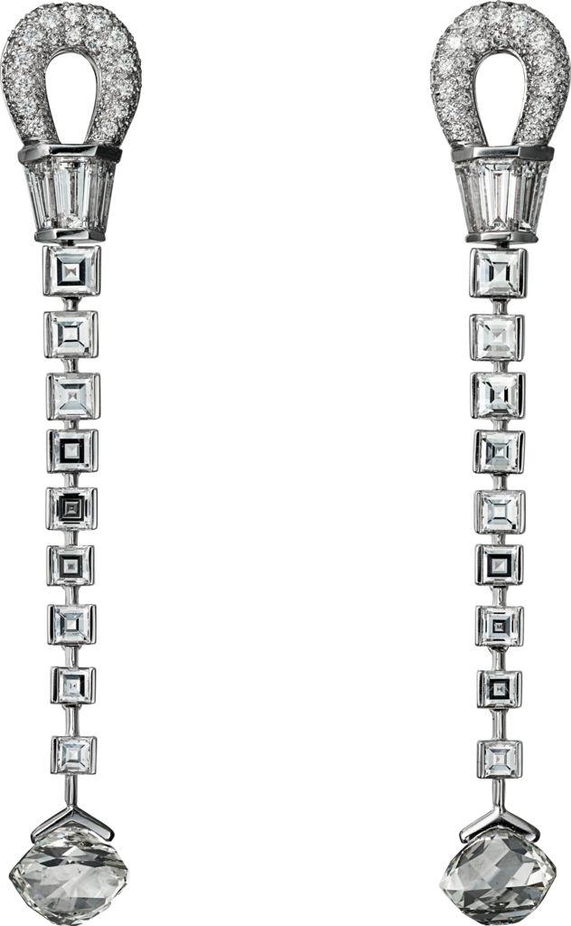 CARTIER. Earrings - platinum, two rectangular novelty-cut diamond totalling 4.33 carats, princess-cut diamonds, tapers diamonds, brilliant-cut diamonds. #Cartier #CartierMagicien #HauteJoaillerie #FineJewelry #Diamond