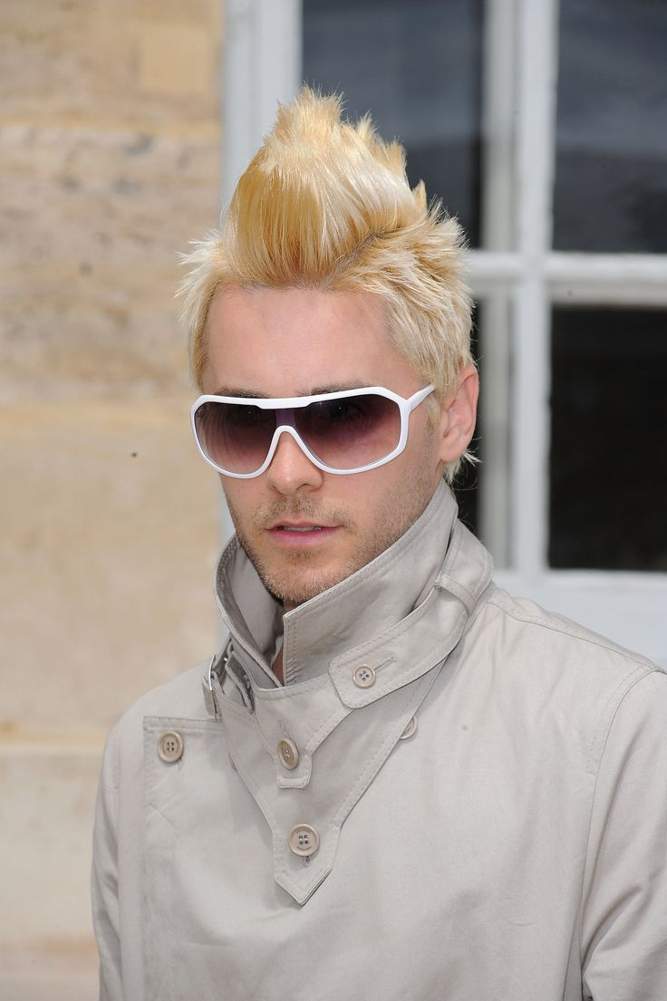 His pink hair was short-lived, though, as he dyed the mohawk completely blond in July.