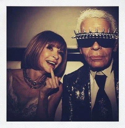 I've never actually seen Anna Wintour smile...or give the finger ;) I guess Karl Lagerfeld brings out her wild side!