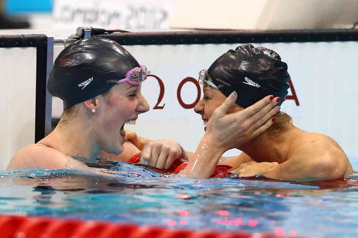 Missy Franklin celebrates winning the women's 200m backstroke final with team mate Elizabeth Beisel on Day 7 of the London 2012 Olympic Games. Beisel placed third in the event.