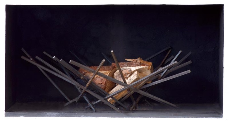 Contemporary version in steel of the traditional fire basket.