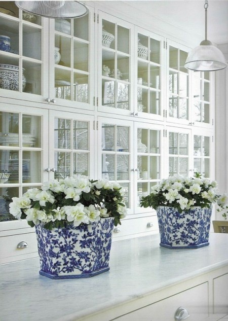 blue and white kitchen accents. glass front cabinets, Carrara marble counter
