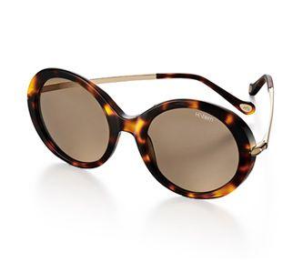Óculos de acetato tartaruga com hastes de metal dourado e lente marrom. Link:http://www.hstern.com.br/joias/p-produto/OC9EA202680/oculos/oculos-hs/oculos-de-acetato-tartaruga-com-hastes-de-metal-dourado-e-lente-marrom