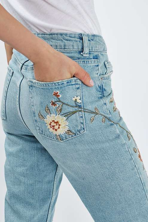 Crafted from pure cotton, our MOTO Mom jeans come in an authentic rigid-look denim. Cut with a high-waist and a tapered leg, they feature multiple pockets and a pretty floral embroidery. Wear them folded at the cuffs to keep them looking cool. #Topshop