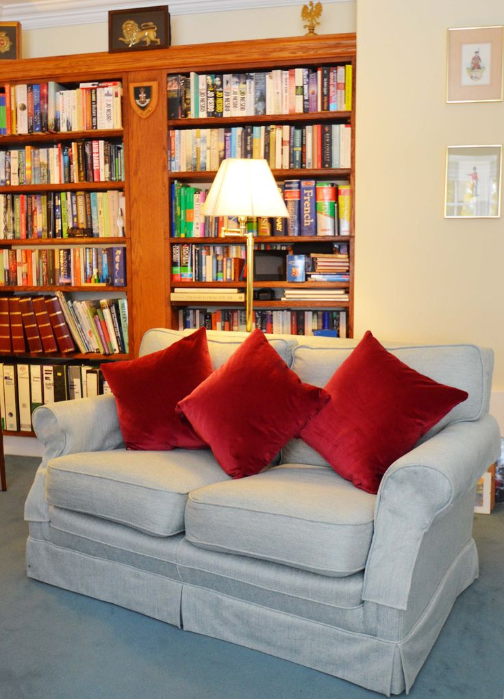 Living room sofa library book case blues and reds www.suescammellinteriors.co.uk