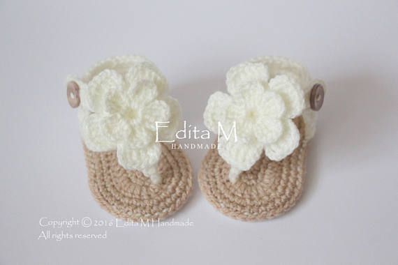 Crochet baby sandals, baby gladiator sandals, flower sandals, baby slippers. Made from acrylic yarn. Size : 0-3 months ( length approx. 9 cm - 3 1/2 inches) Size : 3-6 months ( length approx. 10 cm.- 4 inches )  Hand wash in cool water.  You can find me on Facebook: https://www.facebook.com/EditaMHandmade/   Orders to UK will be shipped by Royal Mail Signed For First Class. Shipping usually takes 1-2 working days.  International orders will be shipped by Royal Mail In...