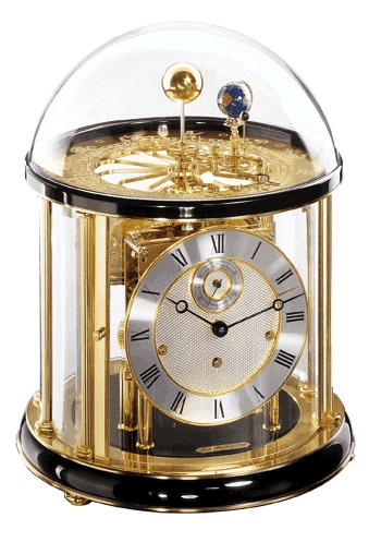 The Tellurium I Mantle Clock by Hermle, is a black Mantel clock that reproduces the annual orbit of the earth around the sun, with the earth rotating around its own axis once in twenty four hours. The moon in turn, revolves around the earth n 29.5 days completing a full rotation around its axis. This allows the reproduction of the different moon phases as they are visible from the earth. http://www.theclocksshop.com