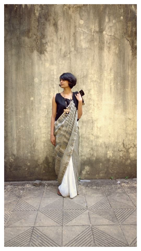Pair your saris with regular shortish tops for a younger look.: