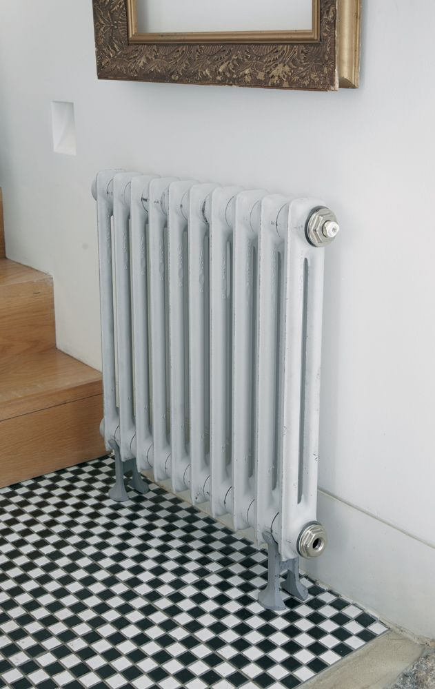 A skinnier radiator will be best for the hallway, i quite like this one (Feature Radiators - Windsor range)
