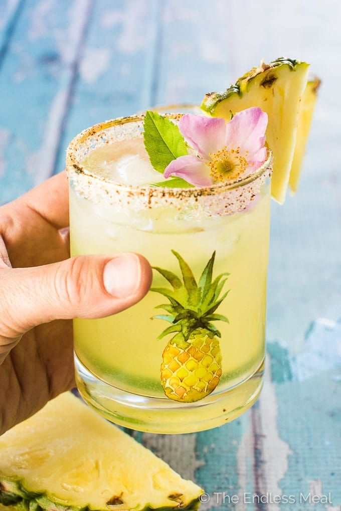 Get your tropical cocktail on with these Fresh Pineapple Margaritas. They're super easy to make and perfect for any weekend BBQ or sunny after work patio drink. Drink up! | theendlessmeal.com | #margaritas #pineapple #wedding #bridalshower #weddingshower #girlsnight #cocktails #summerparty