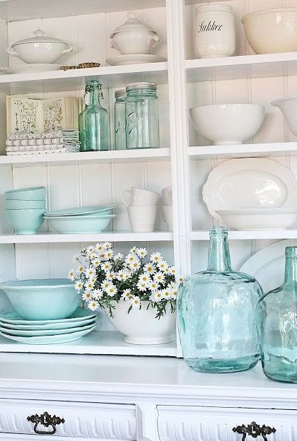 Beautiful tiffany blue kitchen decor idea:  bring a splash of tiffany blue into your kitchen by placing random tiffany blue bowls and glassware on your shelves.